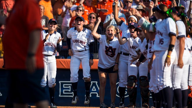 Auburn players wait at home plate for Haley Fagan after she hit a homerun against Arizona in the 5th inning during Game 3 of the NCAA Super Regional on Sunday, May 29, 2016 at Jane B. Moore Field in Auburn, Ala. Auburn won, 6-1.