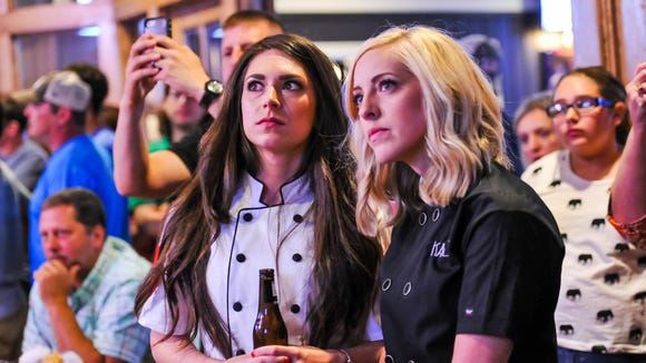 """Fallon Bearb, left, and Kayla Trahan watch their first competition on """"Cake Wars"""" during a June viewing party at Pete's."""