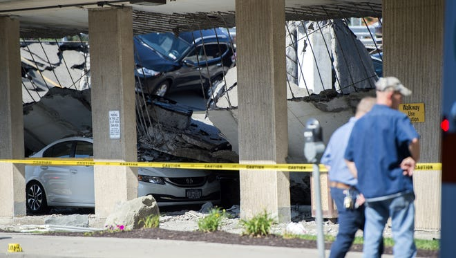 ANDREW THAYER / Staff Photo No fatalities were reported in Thursday?s parking ramp collapse at UHS Wilson Medical Center in Johnson City.