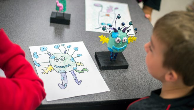 The drawings of 141 Chenango Bridge third-grade students were brought to life by Chenango Valley High School students who sculpted figurines of their younger peers sketches.