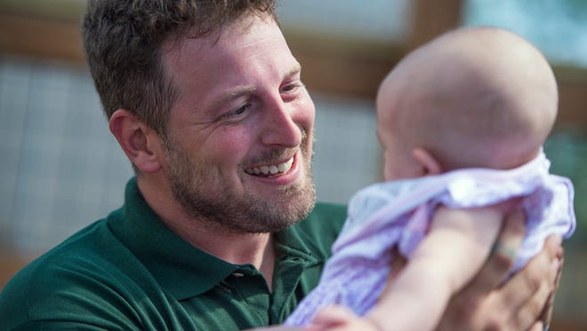 Animal Adventure Park Owner Jordan Patch holds his 4-month-old daughter Ava. Ava was born with agenesis of the corpus callosum, a rare birth defect where the two hemispheres of the brain are not connected.