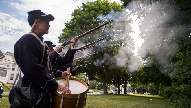 Civil War re-enactors fire a volley during the unveiling ceremony for a historical marker honoring the 137th New York Volunteer Infantry in Binghamton on Thursday. Colonel David Ireland trained the 137th at Camp Susquehanna on Binghamton's South Side before going on to fight in a number of battles during the Civil War, including the Battle of Gettysburg.