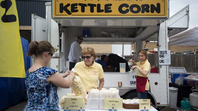 Jan, left, and Brooke Frumes sell A-Maize-N Kettle Corn. The food truck selling flavored kettle corns has already started booking its 2017 schedule.