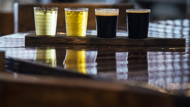A flight of beers is shown on Tuesday, Jul. 5, 2016 at Autauga Creek Craft House in Prattville, Ala. From left to right: Ace Pear Cider; Grayton 30A Beach Blonde Ale; Founders Porter; Stone Imperial Stout.