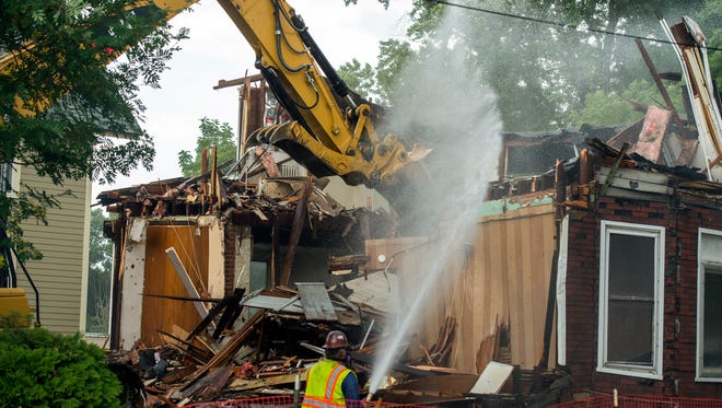 Demolition crews tear down 250 Front St. in Binghamton on Thursday afternoon.