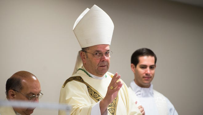 """Bishop Robert Cunningham, of the Syracuse Catholic Diocese, leads a """"Year of Mercy"""" Mass Thursday at Catholic Charities of Broome County in Binghamton."""