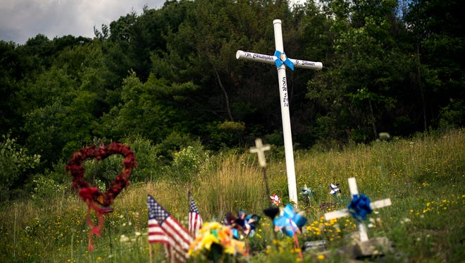 A roadside cross in memory of murdered New York State Trooper Christopher Skinner along Interstate 81 North.