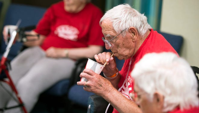 92-year-old Henry Ondreyko sips a root beer float between competitions at the annual Sunshine Olympics at the United Methodist Homes Hilltop Campus in Johnson City on Wednesday.