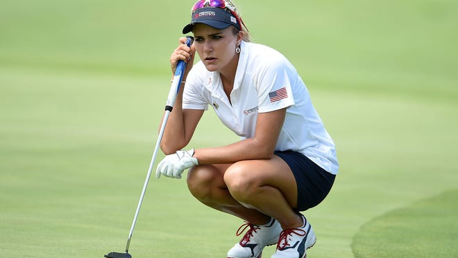 Lexi Thompson of the United States waits to putt Friday on the 14th green during the four-ball session of the UL International Crown at the Merit Club on  in Chicago.