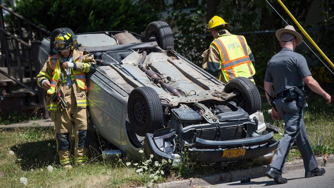 A car overturned in the front yard of a Binghamton home after a one-vehicle crash along Downs Avenue on Saturday afternoon. Minor injuries were reported.