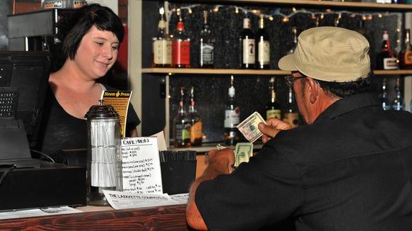 Barista Steeva Montcalm serves a customer at Steam