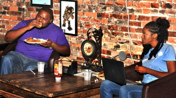 Jeramie Kinnerson and Alex Johnson eat lunch at Steam Press Cafe in downtown Lafayette.