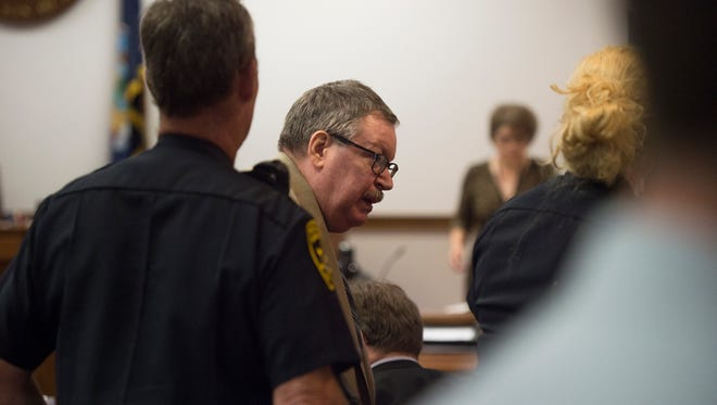 Almond Upton is led out of the courtroom during a recess in proceedings on Wednesday.