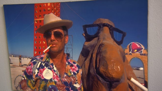 A photo of founder Larry Harvey on the Black Rock Desert playa is seen in the Burning Man headquarters building in San Francisco on Aug. 9, 2016.