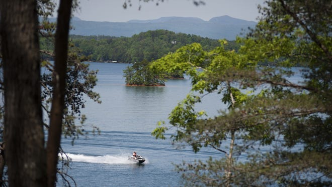 A jet skier is seen on Lake Keowee from a lot at The Landing at Keowee Springs on Friday, April 29, 2016.