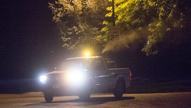 A truck deployed by Larimer County sprays mosquito insecticide on the east side of Fort Collins Wednesday.