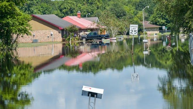 Flood waters remain high along Carmel Dr. August 22, 2016.