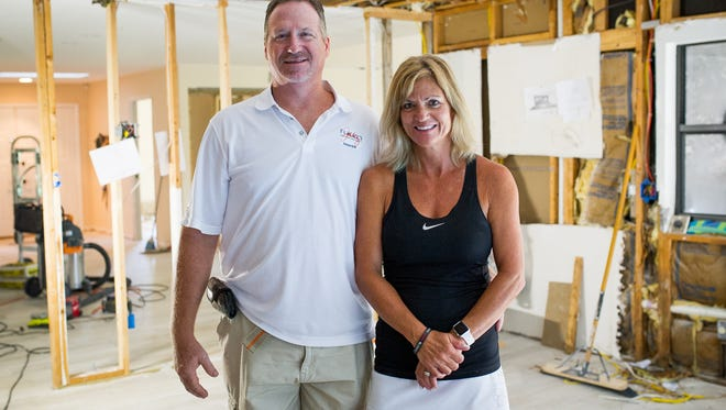 Don and Linda Gallup, from left to right, pose for a photograph during a remodel on Tuesday, Aug. 23, 2016. Linda and Don Gallup moved from Colorado five weeks ago to the naples area and have been renovating their home. Don, a Naples high school grauate in 1985, left for Colorado on a footbal scholarship and is now back with his wife Linda.