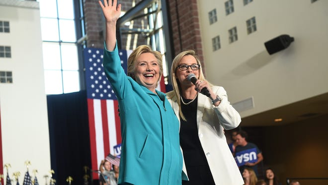 Democratic candidate for president Hillary Clinton gets introduced by Reno's Mayor Schieve at Truckee Meadows Community College in Reno on Aug. 25, 2016.
