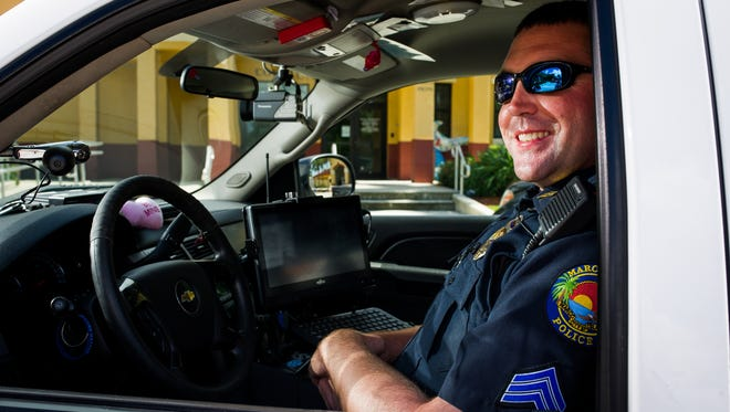 Marco Island Police Sergeant Mark Haueter poses for a photograph at the Marco Island Police Station on Thursday, Aug. 25, 2016. Mark was recently diagnosed with mucoepidermoid carcinoma – a rare mouth cancer. Haueter was first diagnosed with cancer by his ENT specialist in late June 2016. He was immediately referred to cancer specialists at Moffitt Cancer Center in Tampa, Florida.