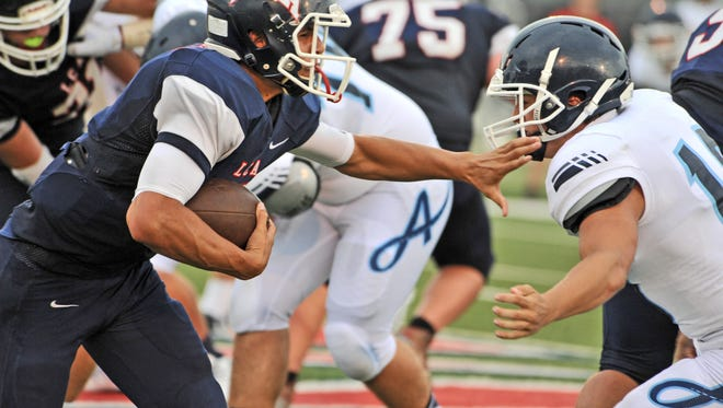 The Lafayette Christian Knights and the Ascension Episcopal Blue Gators battle it out at the Iron Man jamboree opener at the Teurlings Catholic High School football field