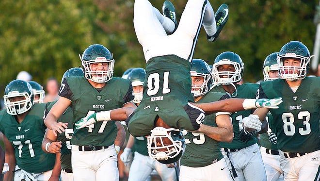Trinity's Santana Jones does a backflip as the team takes to the field.09 September 2016