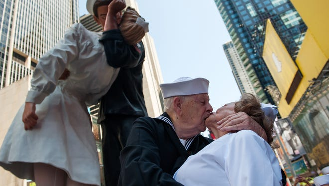 World War II veterans Ray and Ellie Williams recreate the iconic Alfred Eisenstaedt photograph in Times Square on Aug. 14, 2015 in New York City.