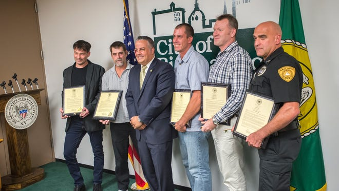 From left, Doug Kumpon, Ed Staff, Binghamton Mayor Richard David, Chris White, Fred Teribury and Albert Fiori, during a ceremony honoring the five men who intervened to help victims of a 10-car pileup along Route 17 East in August.
