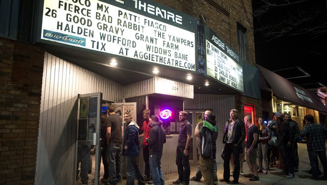 People wait in line at the Aggie Theatre to see the Yawpers play as part of the Fort Collins Music eXperiment festival Friday, April 25, 2014.