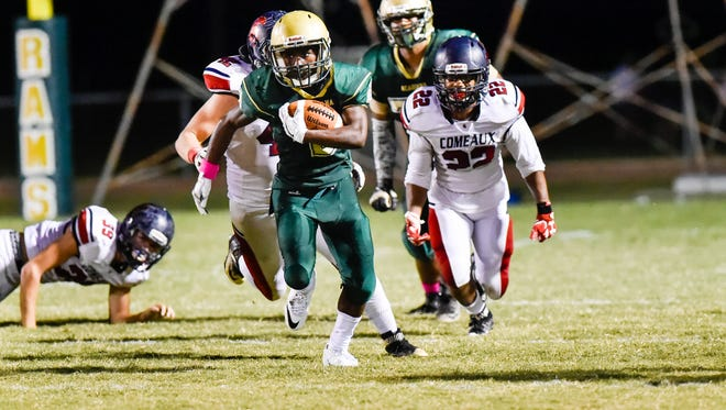 Jaylen James  runs the ball to score a touchdown as the Acadiana Rams host the Comeaux Spartans.