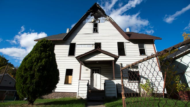 The house at 145 Floral St. in Johnson City remains vacant a year after a fatal arson fire killed two boys, ages 3 and 4, and severely injured their mother.