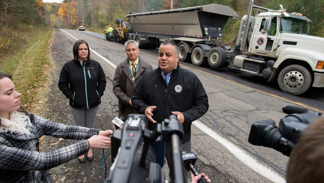 Binghamton Mayor Richard David outlined the city's plans for the final paving project of 2016 as crews paved Pennsylvania Avenue on Wednesday.