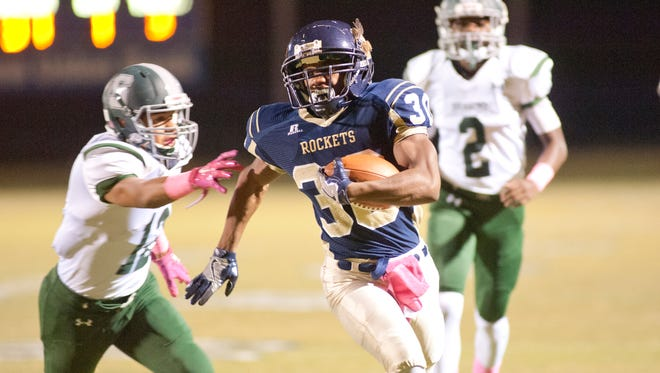 Shelby County running back Caleb Morehead breaks free of South Oldham defensive back John Downing and scores.28 October 2016