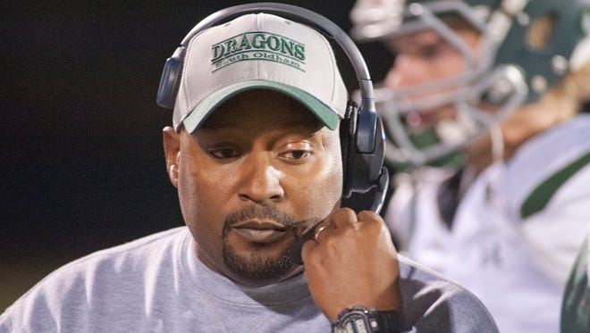 South Oldham Dragons head football coach Jamie Reed talks to his coordinators in the press box.28 October 2016