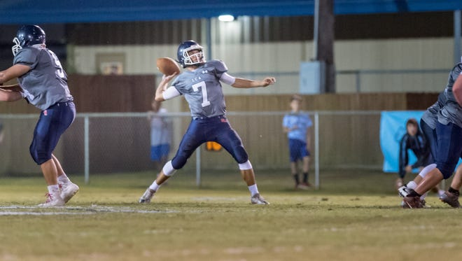 Quarterback Zachary Clement drops back to pass as Lafayette Christian Academy host the Ascension Blue Gators. October 28, 2016.