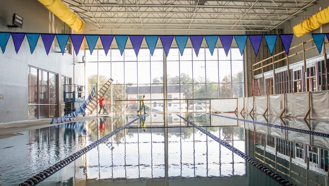Workers put the finishing touches in the pool area at the new Downtown YMCA in Pensacola on Wednesday, November 2, 2016.