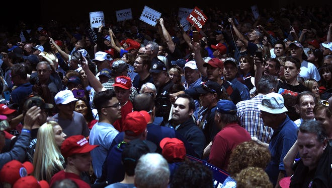Supporters panic after Republican candidate for president Donald Trump got ushered off the stage during a campaign rally at the Reno-Sparks Convention Center on Saturday.