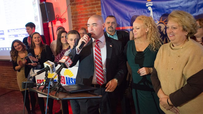 State Sen. Fred Akshar delivers his victory speech in front of Broome Republicans in Binghamton after winning re-election on Tuesday, Nov. 8, 2016.