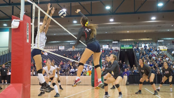 Jolie Hidalgo hits around the block as Teurlings Catholic takes on Ursuline in the LHSAA State Volleyball Finals. November 12, 2016.