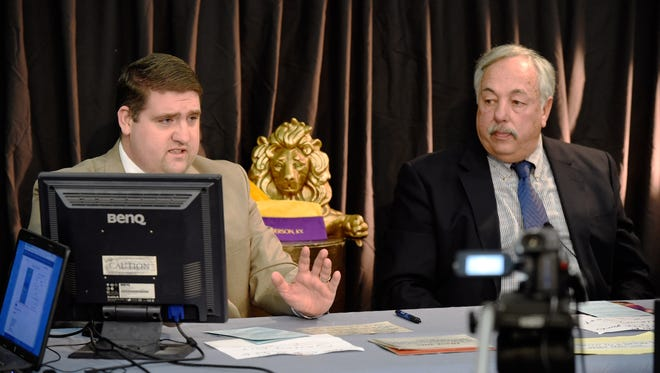 MIKE LAWRENCE / THE GLEANER  On air personalities Eric Shapell (left) and Mike Smith broadcasting Monday during the first day of the 19th annual Henderson Lions Club Auction, February 8, 2016.