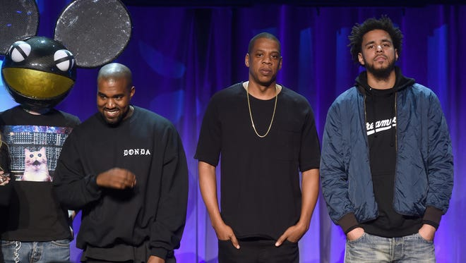 Deadmau5, Kanye West, JAY Z and J. Cole onstage at the Tidal launch event in March 2015.