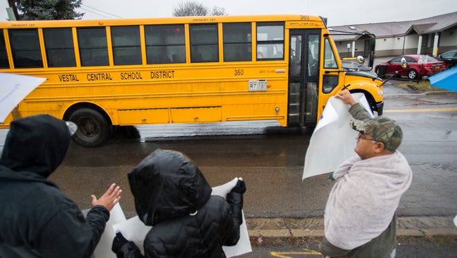 About 20 people gathered outside Vestal High School to protest the suspension of a student who was involved in an alleged racially charged incident with a teacher on Tuesday, Jan. 3, 2017.