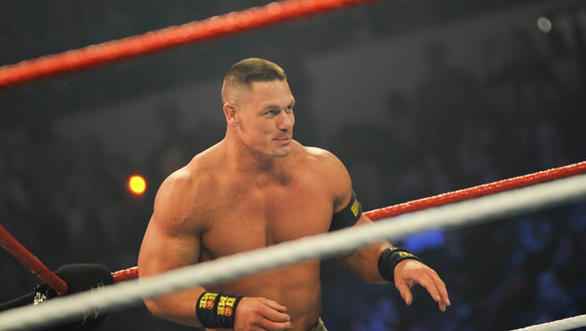 NORFOLK, VA - DECEMBER 09: WWE Superstar John Cena performs during the 10th anniversary of WWE Tribute to the Troops at Norfolk Scope Arena on December 9, 2012 in Norfolk, Virginia.