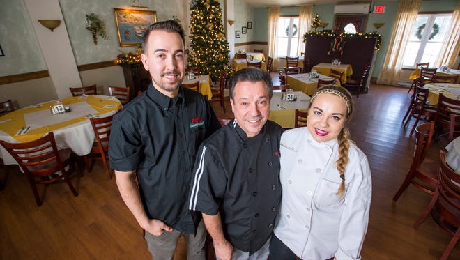 Frank's Italian Restaurant owner Frank Lo Piccolo, center, with his son Lou, and daughter Gabriella inside the expanded seating area in their Town of Maine restaurant.