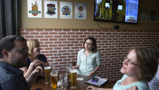 Customers enjoy beers at CooperSmith's Pub & Brewing.