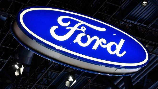 A Ford sign is displayed at its booth at CES 2017 at the Las Vegas Convention Center on January 5, 2017.