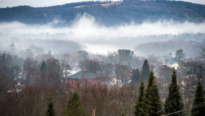 The Village of Nichols shrouded in mist on Wednesday.