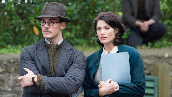 "This image released by the Sundance Institute shows Sam Claflin, left, and Gemma Arterton in a scene from ""Their Finest,"" an official selection of the Spotlight program at the 2017 Sundance Film Festival. The film reunites filmmaker Lone Scherfig with Claflin, who worked together previously in ""Riot Club."" (Nicola Dove/Sundance Institute via AP)"