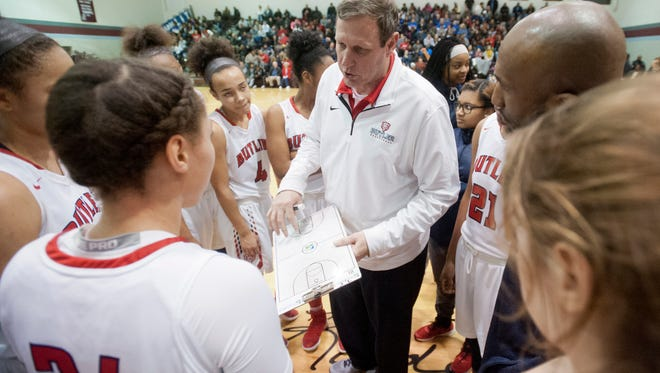 Butler head basketball coach Larry Just charts a play during a time-out in the Girls' LIT championship.28 January 2017