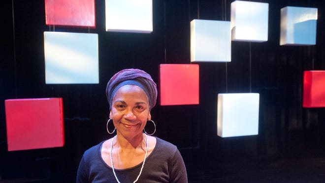 "Director of the University of Louisville Theater Arts production of ""Baltimore,"" and U of L Theater Arts professor Nefertiti Burton on the play's set. The play explores racial relationships on a college campus including discussions of their own self-images, the relationship they have with friends, family and the world around them.